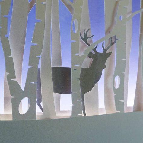 Luz del ciervo enmarcado noche de invierno.