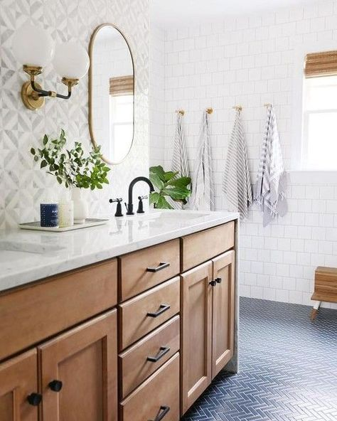 Modern Farmhouse Bathroom Renovation: Gorgeous wooden vanity with carrara marble countertop and mid century style knobs and pulls from Schoolhouse electric. This bathroom also features a blue herringbone tile floor and marble mosaic tile backsplash. Bad Inspiration, Bathroom Inspiration, Ideas Baños, Decor Ideas, Decorating Ideas, Decor Diy, Wood Ideas, Wall Decor, Herringbone Tile Floors