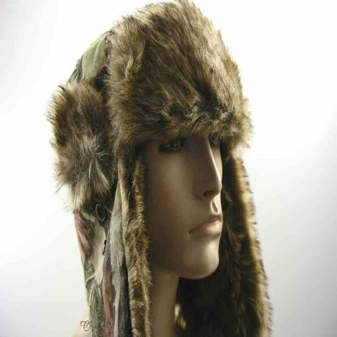 fe548f817b1ff Leaf camo trooper hat with faux fur trim and warm ear flaps. This unisex  camouflage trooper hat is nicely trimmed with synthetic fur material.