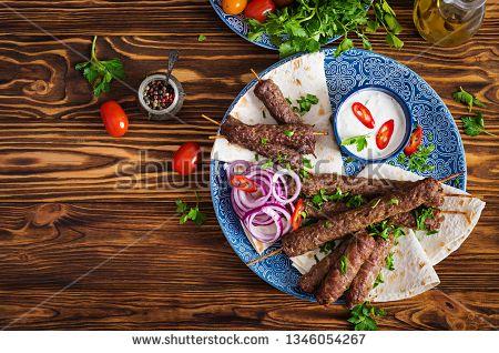Stock Photo Turkish And Arabic Traditional Ramadan Mix Kebab Plate Kebab Adana Chicken Lamb And Beef On Lavash Bread W Kebab Vegetable Kebabs Georgian Food
