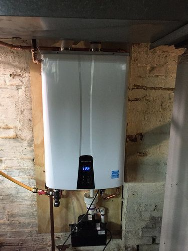 A Professionally Installed Navien Tankless Hot Water Heater Done Tankless Hot Water Heater Water Heater Hot Water Heater