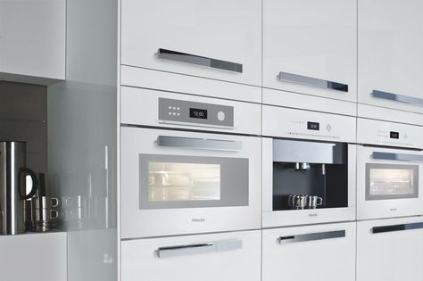 Brilliant white gloss kitchen matched with Miele appliances