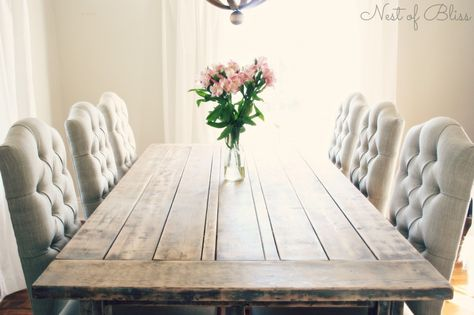 A rustic farmhouse table paired with beautiful tufted dining chairs with linen-like upholstery from Wicker Emporium. The chairs are the Jasper Chairs.