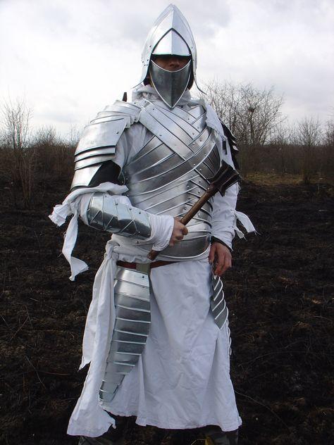 Armor is made of steel plate. Set includes helmet, breastplate, 2 knee protectors, 2 shoulder pads and 2 bracers.