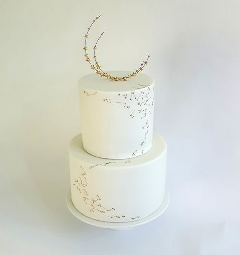 25 New Takes on Traditional Wedding Cake Flavors - white wedding cake with moon and stars -
