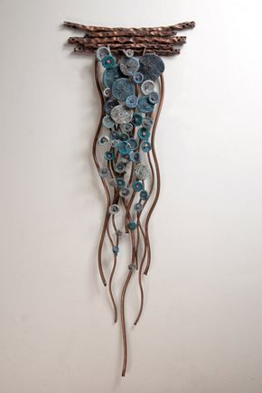 Flow in Blues by Hannie Goldgewicht. Hand-formed copper wall sculpture with ceramic details. Each piece is unique. Slight variations may occur.