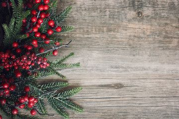 Christmas Wood Background.Christmas Evergreen Branches And Berries Over Rustic Wood