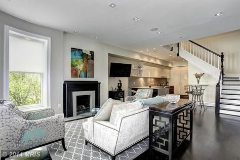 This living room's decor is really trendy and cool. Between the decorative rug and two contrasting fabrics on both the couch and chair this room is bound to impress. Washington, DC Coldwell Banker Residential Brokerage