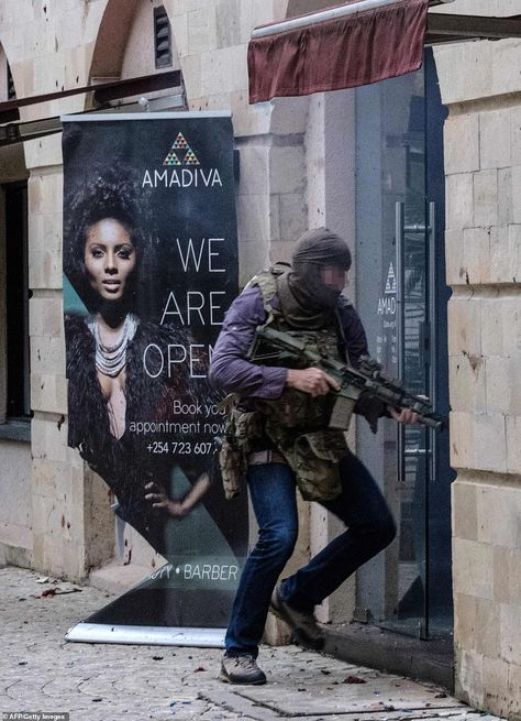 The British special forces soldier enters the building in Nairobi, Kenya, carrying his