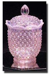 """Pink Chiffon Opalescent is a color introduced in 2001.    According to the Fenton Art Glass catalog """"This unique color is achieved by adding erbium and bone ash to the glass formula to create an exceptional opalescent shade of pink that remains true to color in different shades of lighting""""."""