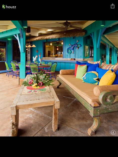 Great key west decor,  I love the wall art and the day bed.