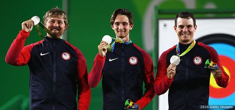 (L-R) Brady Ellison, Zach Garrett and Jake Kaminski celebrate with their silver medals after finishing second in the men's team final match at the Rio 2016 Olympic Games at the Sambodromo on Aug. 6, 2016 in Rio de Janeiro.1
