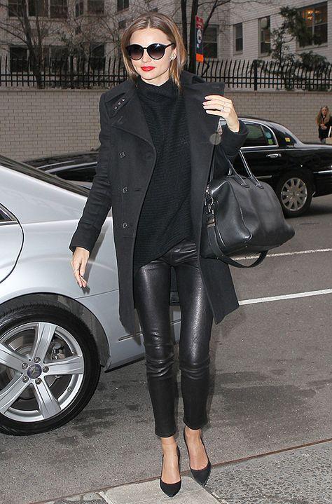 Miranda Kerr wearing a Givenchy coat, The Row sweater, a Givenchy bag, Stella McCartney sunnies & Manolo Blahnik heels.
