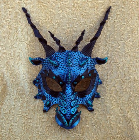 Merimask's Dragon of Thorns. It's handcrafted 8 ounce leather with polymer clay protrusions. Just simply breathtaking
