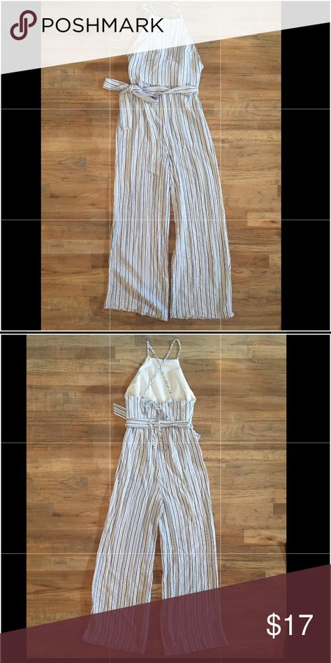 Women's Jumpsuit Blue and white striped jumpsuit. Ties in the front and criss cross ties on your back Forever 21 Pants Jumpsuits & Rompers