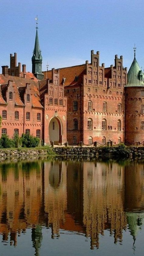14th century Egeskov Castle in Funen, Denmark.  Built on a lake and originally accessible only by drawbridge, the name means