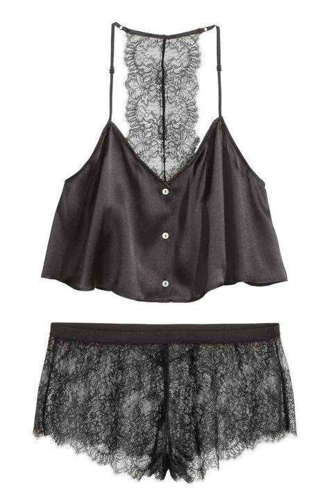 Pyjamas in silk and lace: PREMIUM QUALITY. Pyjamas comprising a short satin top made from mulberry silk and lace shorts. The top has a V-neck, buttons down the front, narrow, adjustable shoulder straps and a lace racer back. Short shorts with an elasticated waist and lined gusset.