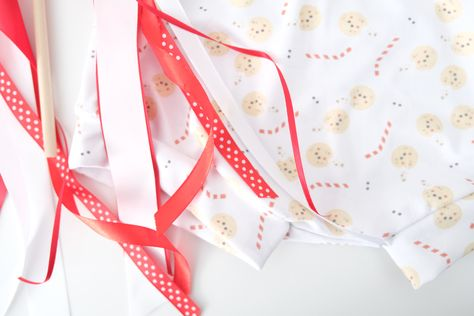 Merry Christmas! This adorable photo prop is perfect for your babies first Christmas or your toddler's Christmas photoshoot. Hang it in a stocking, on top of a present, or in front of the Christmas tree. This Christmas pennant flag is the perfect way to celebrate the holidays. #merrychristmas #christmasdecor #uniquechristmaswrapping #christmasflag #babysfirstchristmas #christmascookies #christmasbaking #christmastreats #winterwonderland #snowflakeflag #winterwonderlandparty #christmasparty