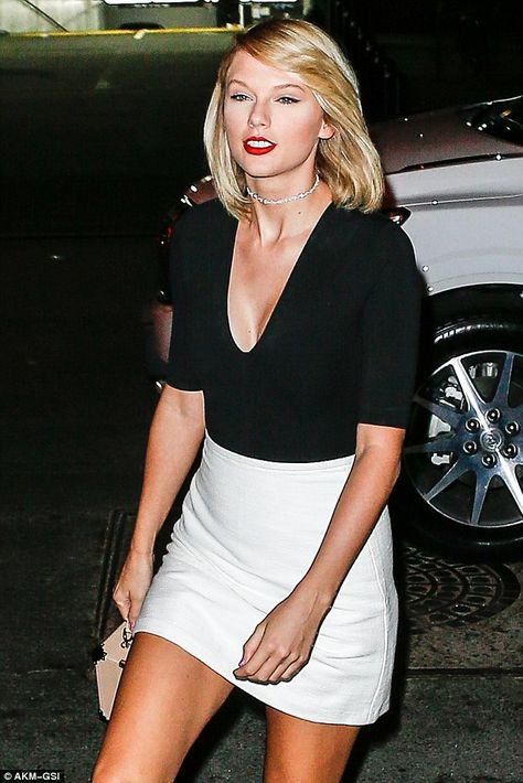 Onwards and upwards: With her model gal pal by her side, Taylor held her head up…