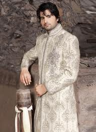 Gauge your own personality glowing in this white shade sherwani. Features decorative banarasi patterns on a lenin fabric, inspired by a kadhi like texture. Bugle bead embellished decorative patterns and decorative stone studded buttis adds charm.