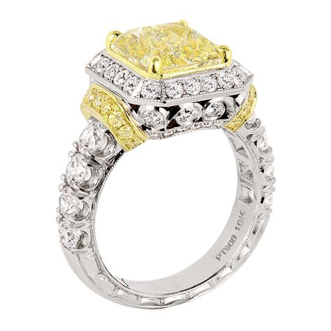 This ring is simply a stunner! By Jack Kelege, it combines platinum and 18k yellow gold and features 2.02 ctw of round White Diamonds, and 0.55 ctw of Fancy Yellow Diamonds in a gorgeously detailed setting around the double-prong held fancy yellow center diamond.  What a masterpiece! www.diamonds.pro