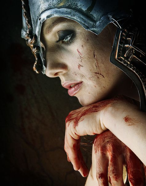 The most true to life photo of a woman warrior I've seen.  This is what doing battle is really like, not some half dressed chic with big...well, you know.