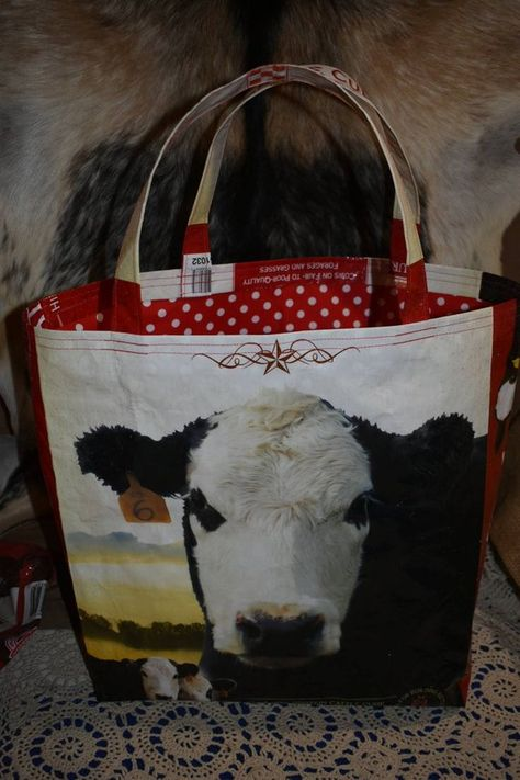 Items similar to Upcycled/Recycled feed sack w/bald face cow/cattle with a red polka dot liner tote/bag/purse/shopping bag/stock show/ffa on Etsy