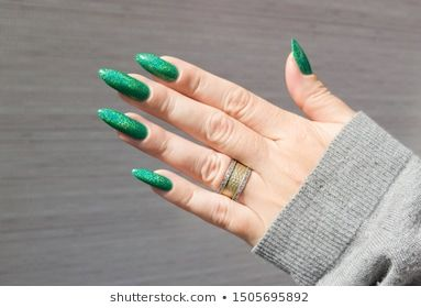 Female Hand With Female Hand With Long Nails And A Bottle Of Neon Emerald Green Nail Polish Emerald Green Nail Polish Green Nails Green Nail Polish