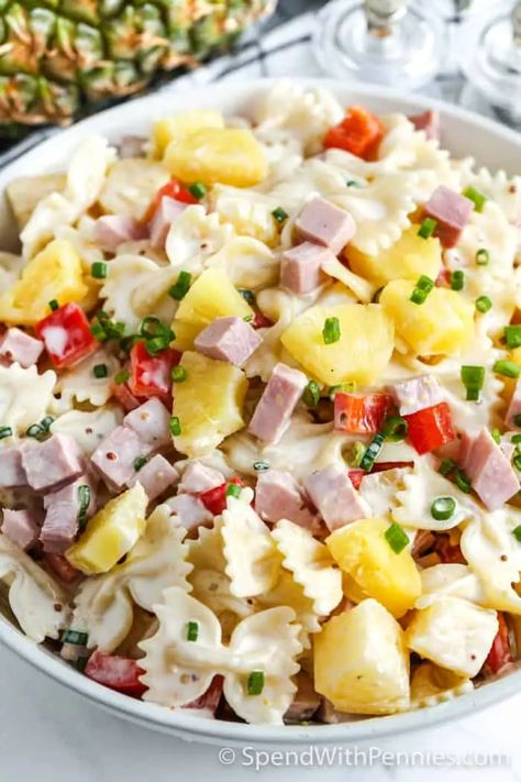 This pasta salad is jam packed with ham and pineapple for the best flavor. Its an easy pasta salad recipe that everyone raves about with a simple pineapple dressing. #SpendWithPennies #pastasalad #hamandpineapple #ham #hampastasalad