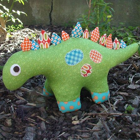 """Dilbert the dinosaur is the perfect cuddle buddy for those dinosaur-loving boys in your life. This pattern is suitable for all skill levels.Completed size: approximately 20cm tall x 35cm long (8"""" x 14"""")Pattern contains full step-by-step instructions and the full sized templates to create your own Dilbert the Dinosaur."""