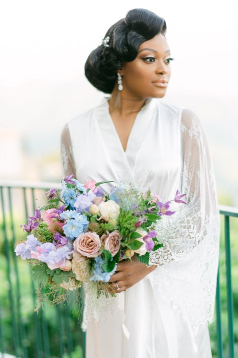 From the editorial This Stunning Destination Wedding in Ravello Was Planned in Just 45 Days! Kuts Flowers decorated this day with delphiniums, roses, hydrangeas and anthuriums in delicate pink and pastel blue tones - perfectly matching the enchanted garden vibes.  LBB Photographer: @laceandluce  #weddingbouquet #bridebouquet #weddingflowers #bouquetinspiration #pastelbouquet