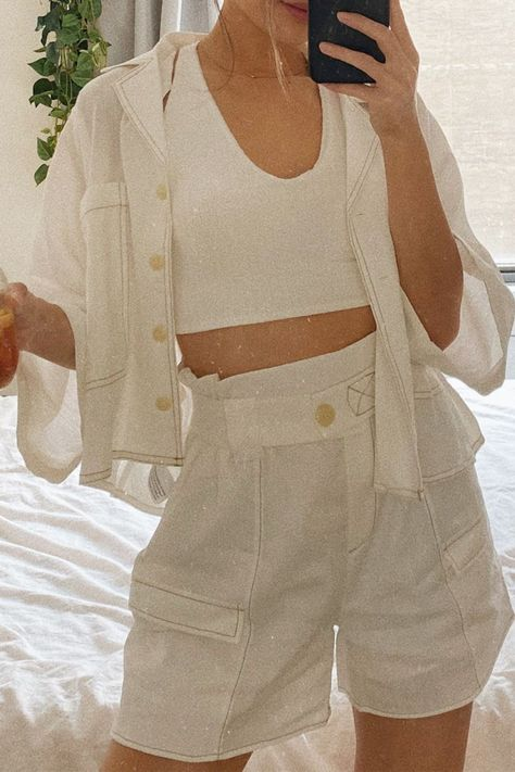 The Cultivated Style White Paper Bag Waist Shorts are a covertable piece that shows you've got style! This matching set can easily be interchanged for endless cute summer outfits. The breezy oversized button-up top paired with white paperbag waist shorts are two summer basics you'll be wearing all summer long! #lovelulus
