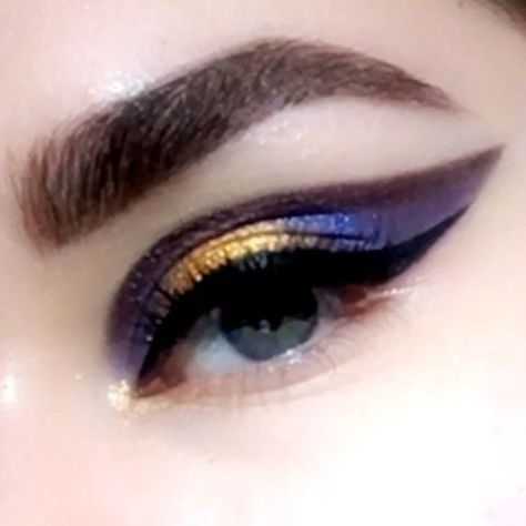 Galaxy winged eye makeup tutorial to make your eyes look stunning with a winged space inspired style.