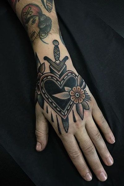 25 Awesome Hand Tattoo Designs In 2020 Traditional Hand Tattoo Traditional Tattoo Flowers Black Heart Tattoos
