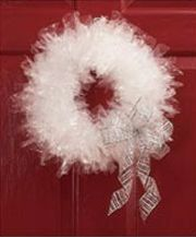 """Christmas Wreath made of dry cleaner bags!   Addie's class made these and we used a strut hanger (the pants hanger with the cardboard piece) for the base and it took about 1-1/2 garment bags cut into strips about 4""""x6"""" for a kid-size wreath."""