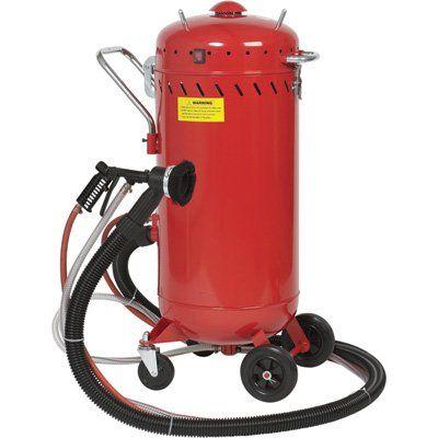 Loading Abrasive Blaster Vacuums Abrasive