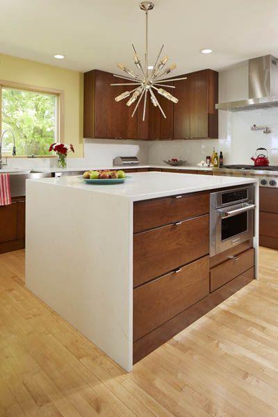 Mid Century Modern Cherry Kitchen Accented By A Waterfall Island Mid Century Modern Kitchen Island Cherry Cabinets Kitchen Mid Century Modern Kitchen