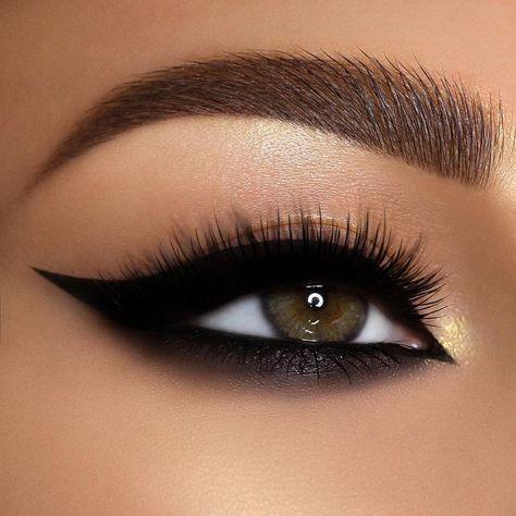 Winged cateye makeup with bold lashes created with the *NEW* limited edition PAT McGRATH LABS FetishEYES XTREME EYE TRIO KIT.  #FetishEYES Mascara 🖤 Permagel Ultra Glide Eyeliner in 'XTREME BLACK' 🖤Perma Precision Liquid Eyeliner 👁️️️: @alexandra_anele _