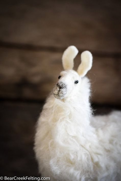 Lovingly designed and hand-crafted by Fiber Artist Teresa Perleberg, this adorable needle felted Llama is bursting personality! The perfect gift for llama fans.  This beautiful Llama:  • has a solid wool body • has little glass eyes • is an original design • will make you smile • the Llama pictured