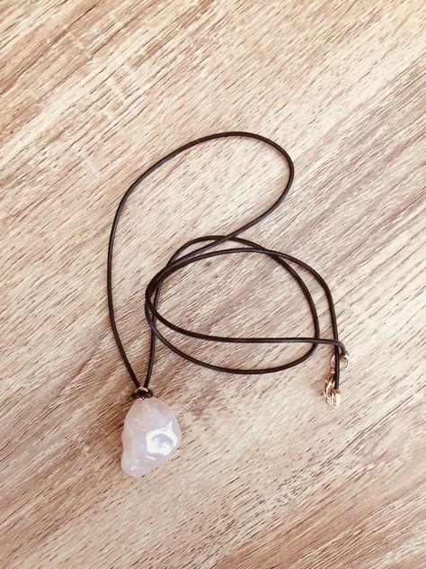 Rose quartz pendant with leather cord