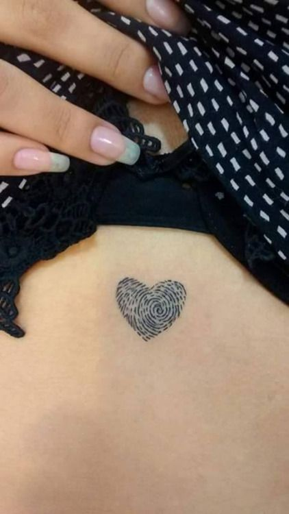 Small heart fingerprint tattoo.