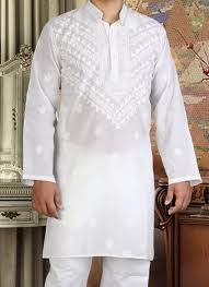 Look elegantly clad in this white shade kurta pyjama. Features chikan embroidered decorative motifs and patterns. Fancy buttons accentuates the neckline. Paired with a matching bottom and dupatta.