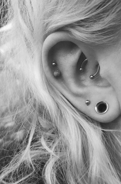 My ears currently are: Daith, helix, lobes and stretched lobes #daith #piercings #piercing #helix #doublehelix #lobes #constellation #stretchedears #stretchers #b&w #myear