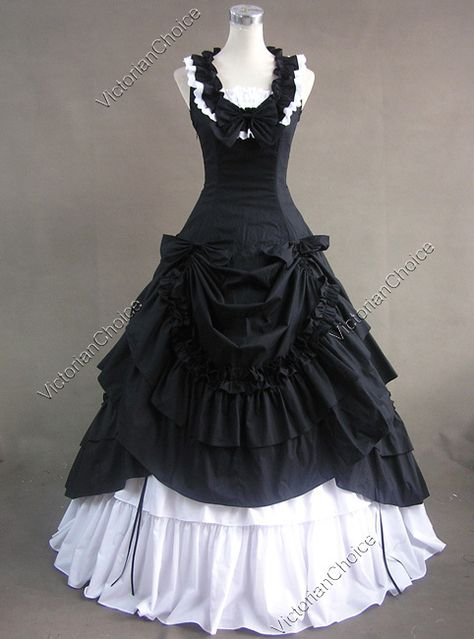 late 1800's dress style  This looks like a Mourning dress years after the deceased.