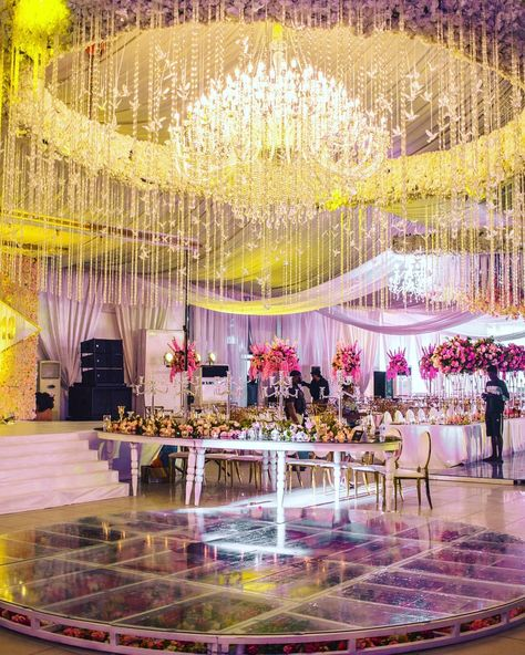Massive round glass and floral dance floor with beautiful over the top crystal and floral ceiling installation. #peep the over 300 pieces of acrylic birds in there. 💗💃💃🕺🕺 Decor by @nwandossignatureevents  Let's create your fantasy. #lifeofadecorator #nwandossignaturetables We design your venue according to your desire.... We love beautiful and pretty decors. Don't you? #nigerianwedding @weddingshakara #weddingdecors #nsceilinginstallation #bellanijaweddings #nwandossignatureweddings #weddin