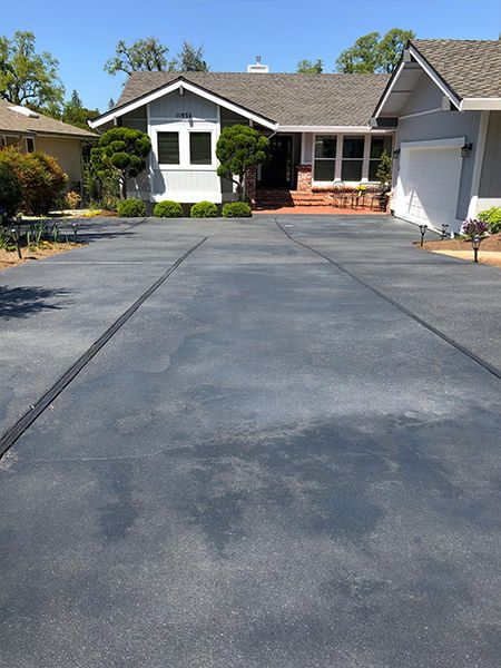 Obsidian Grey Stained Concrete Driveway With Matte Finish