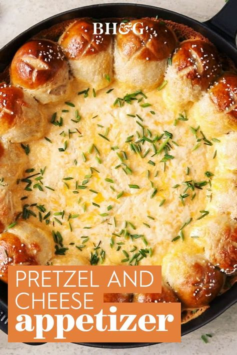 Cheese dip is good. Cheese dip infused with beer is even better. And beer-cheese dip served with pretzels? Downright irresistible! This appetizer recipe will have everyone jockeying for the last dunk. #beercheesedip #pretzelrecipe #homemadepretzels #appetizer #fingerfoods #bhg