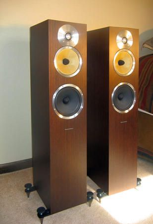 B&W CM& Loudspeakers mounted with outriggers with spikes