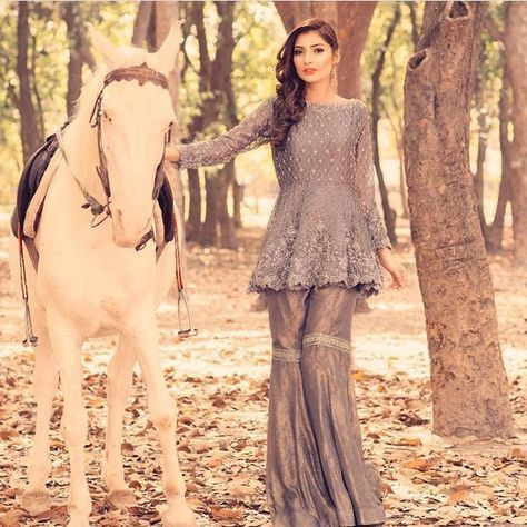 Perfect metallic hues 💎 we are loving this grey Peplum top with gharara trouser by The Ivy - pakistanvogue