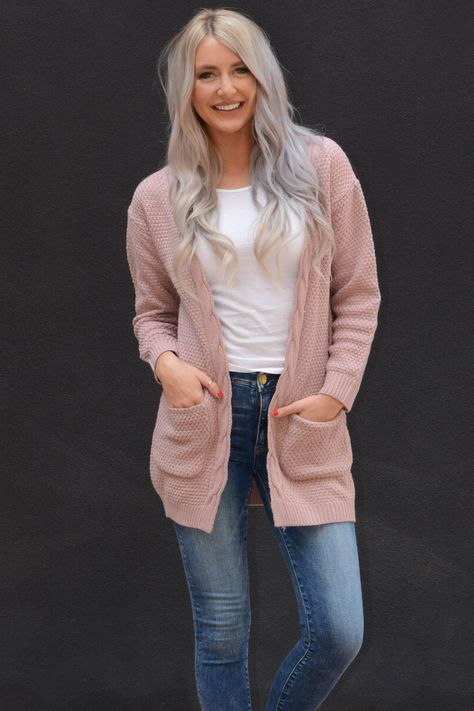We are in season for hot coco and bon fires and that calls for the perfect cozy cardigan. Pair with your favorite top, jeans and boots and you are set for all the winter fun! Features a thick knit fabric, long sleeves and front pockets. Size - Small 0-4 - Medium 6-8 - Large 10-12 - X Large 14-16 - XX Large 18-20 Runs true to size. Length of small approx. 30